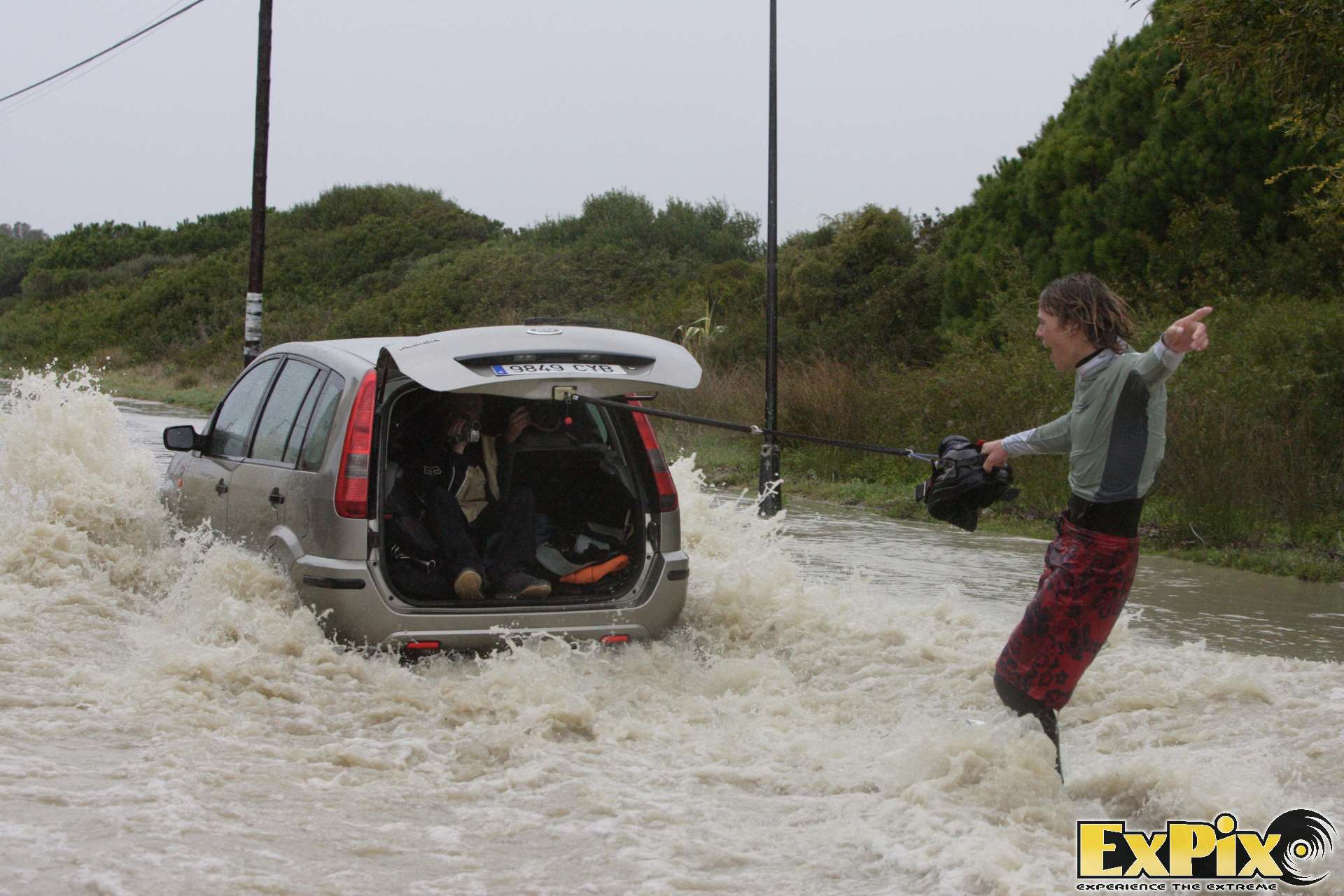 Lewis Crathern Kiteboarder Wakeboarding behind a car